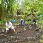 Volunteers build a dry stream bed in the Agro-forest.