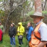 J.B. Friday talks to the group about a thinning trail.