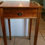 Ron Hester's finished end table with handmade cast bronze plumeria drawer pull.